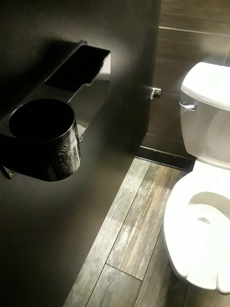 cupholder in toilet stall